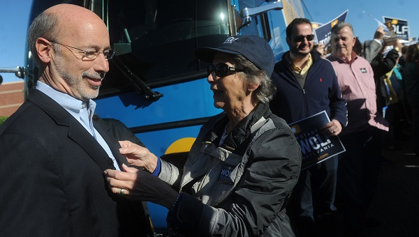 Tom Wolf's mother, Cornelia, straightens out his coat following a rally before to kick off his bus tour on Friday, Oct. 24, 2014. (York Daily Record file)