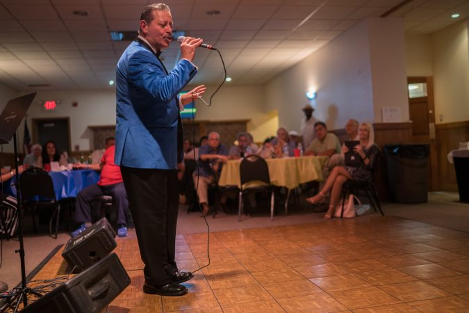 Gil Torres of Blue Velvet performs at the Father's Day spaghetti dinner at the South Philly String Band Club. (Branden Eastwood for WHYY)