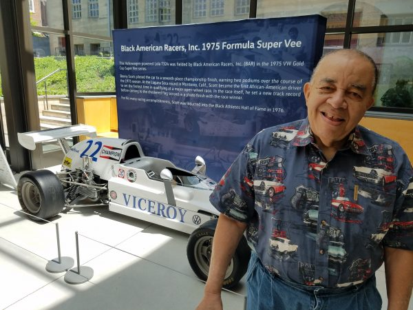 Leonard Miller at the Mercer Museum, with the Formula Vee car his team – the Black American Racers – raced. (Peter Crimmins/WHYY)