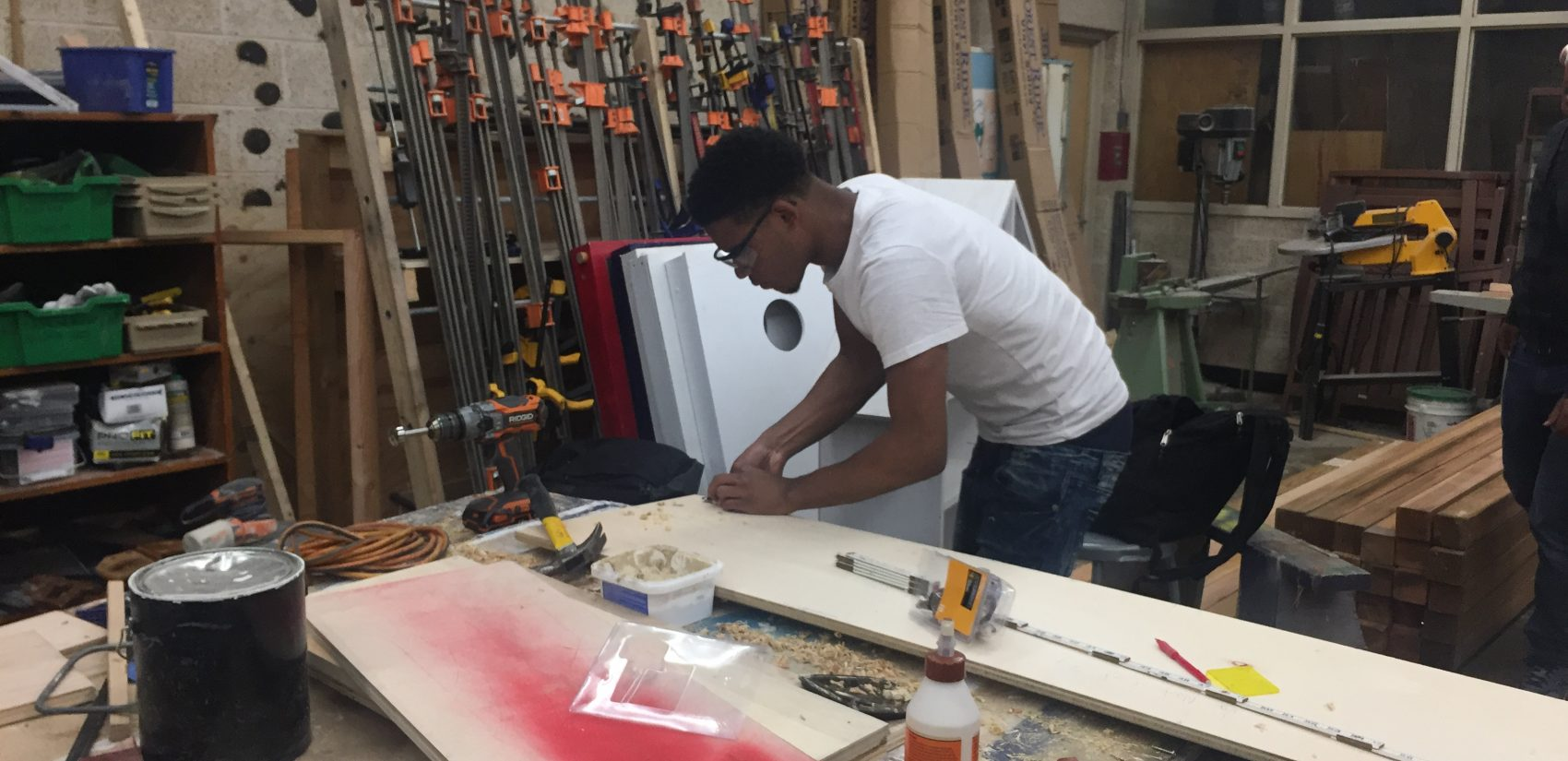 A student in Mac Emerson's construction tech class at William Penn works on a project. (Cris Barrish/WHYY)