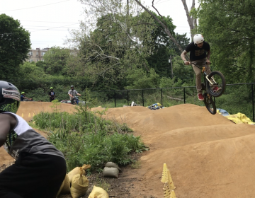 Riders on the Philly Pump Track in West Fairmount Park. It's free, and has bikes and helmets to borrow. (Photo: Michael Kasama)