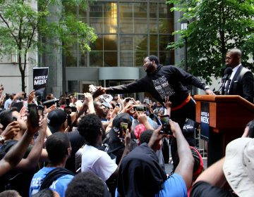 Meek Mill reaches out to supporters outside the Criminal Justice Center before his hearing to ask for a new trial on 10-year-old gun and drug charges.