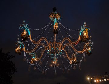 Eight musicians play on the chandelier as it moves over the stage, crowd and the Schuylkill River. (Lindsay Lazarski/WHYY)