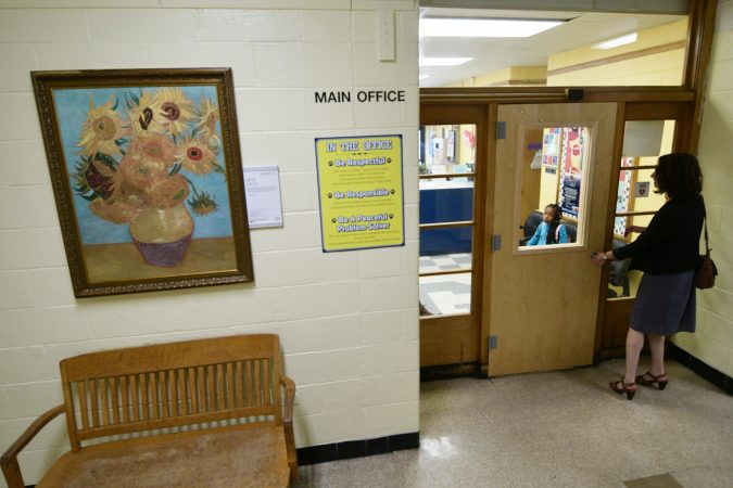A replica of the Sunflowers, by Vincent van Gogh (1853-1890, the Netherlands) hangs in the hallway of Edward Gideon Elementary School, next to the Main Office. (Bastiaan Slabbers for WHYY)