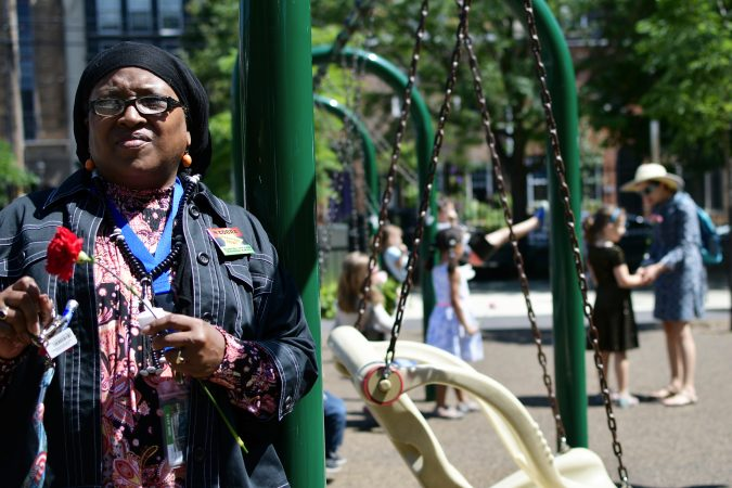 Nabila Bay, who works nearby, came in support of honoring ancestors as the city makes an announcement of the development of Bethel Burying Ground Historic Site Memorial at Weccacoe Playground, in South Philadelphia, on Tuesday June 12, 2018. (Bastiaan Slabbers for WHYY)