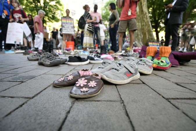Shoes were displayed to symbolize the children separated from their parents by U.S. immigration officials. (Bastiaan Slabbers for WHYY)