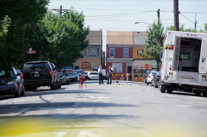 Police investigate the crime scene outside the Historic Roebling Wire Works building on the corner of Dye Street and S. Clinton Avenue in Trenton, N.J. A suspect is dead and 22 people are injured after a shooting at an all-night arts festival being held there. (Natalie Piserchio for WHYY)