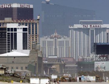 Casinos are seen along the boardwalk in Atlantic City, N.J., Monday, June 19, 2017. From left to right, Bally's, Caesars, Resorts, and the former Trump Taj Mahal. In the background is the former Revel Casino. (AP Photo/Seth Wenig)