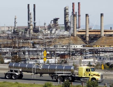 A 2012 fire at the Chevron Refinery in Richmond, Calif., led the state to update regulations governing how disasters at refineries are investigated, and requiring companies to disclose information to emergency workers and citizens. The Environmental Protection Agency is moving to block similar federal chemical regulations from taking effect. (Paul Sakuma/AP)