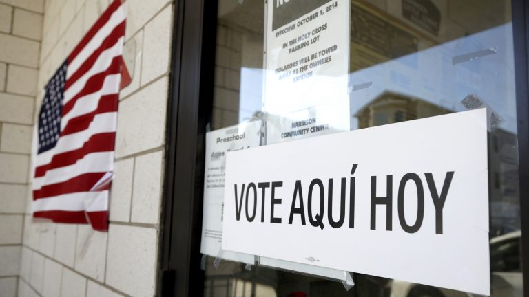 A sign announces a polling place in Spanish outside of the Harrison Community Center during New Jersey's primary election June 5. (Julio Cortez/AP)