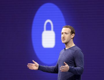 Facebook CEO Mark Zuckerberg is pictured at F8, Facebook's developer conference last month. On Thursday, the company announced a new test feature had changed users' privacy settings without their consent. (Marcio Jose Sanchez/AP)