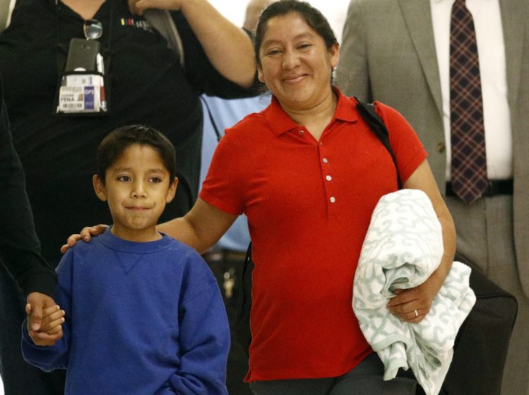 Darwin Mejia, 7, saw his mother for the first time early Friday, reuniting with Beata Mariana de Jesus Mejia-Mejia at Baltimore-Washington International Thurgood Marshall Airport after they were separated at the border by U.S. agents (Patrick Semansky/AP)