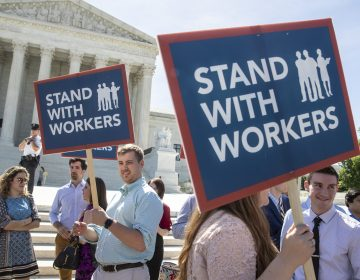 People gather at the Supreme Court awaiting a decision in an Illinois union dues case, Janus v. AFSCME, on Monday. (J. Scott Applewhite/AP)