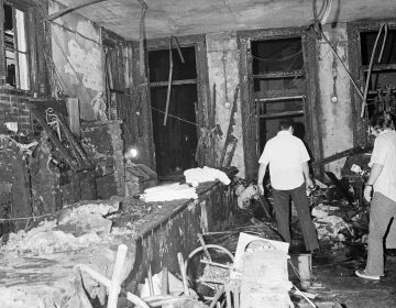 A view inside the Up Stairs bar following a fire that left 32 dead and several more injured, seen on June 25, 1973. Most of the victims were found near the windows in the background. (Jack Thornell/AP)