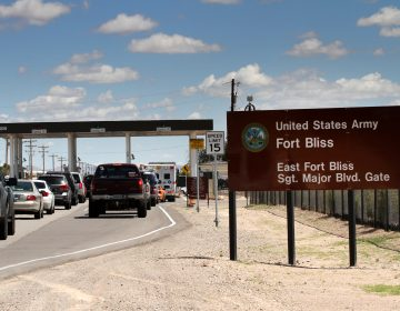 Cars wait to enter Fort Bliss in El Paso, Texas, in 2014. The U.S. Army Base is one of four that likely will be tasked with housing immigrant children following a request Thursday by the Department of Health and Human Services. (Juan Carlos Llorca/AP)