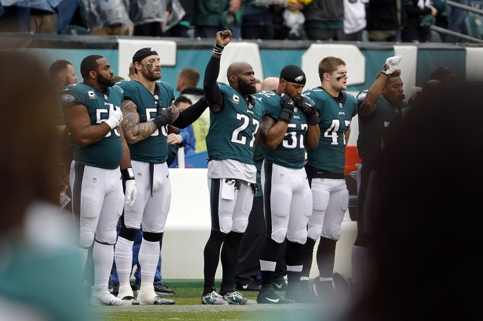 Philadelphia Eagles' Malcolm Jenkins (27) raises his fist during the playing of the national anthem ahead of an NFL football game against the San Francisco 49ers, Sunday, Oct. 29, 2017, in Philadelphia. (AP Photo/Chris Szagola)