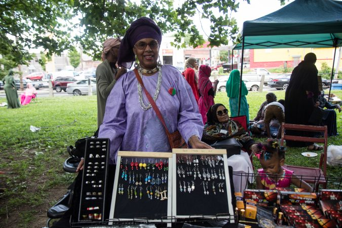 Safiyat Muhammad sells earrings she made at an Eid al-Fitr celebration, marking the end of Ramadan. (Kimberly Paynter/WHYY)