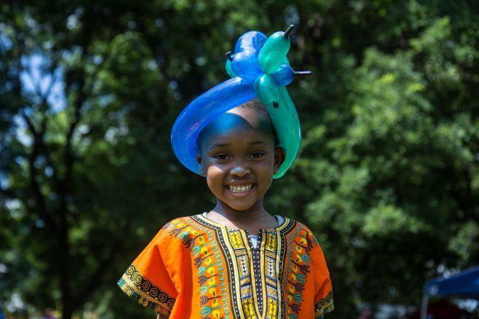 Bailey Mercedat, 4, received a balloon crown at an Eid al-Fitr celebration, marking the end of Ramadan. (Kimberly Paynter/WHYY)