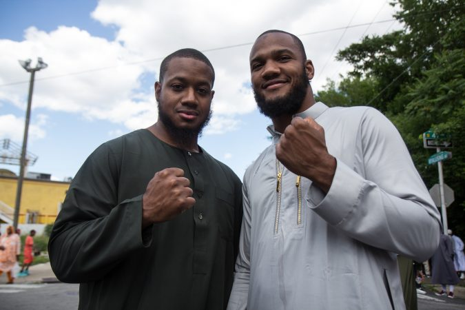 Samir Salahubdin, and Julian Williams, boxers in West Philadelphia, put up their fists during an Eid al-Fitr celebration, marking the end of Ramadan. (Kimberly Paynter/WHYY)