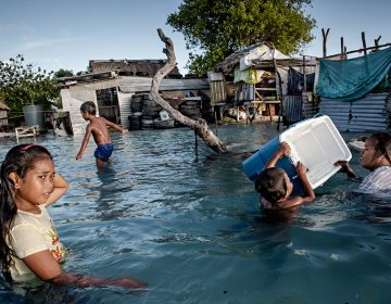 In Kiribati, an island republic in the Central Pacific, large parts of the village Eita (above) have succumbed to flooding from the sea. (Jonas Gratzer/LightRocket via Getty Images)