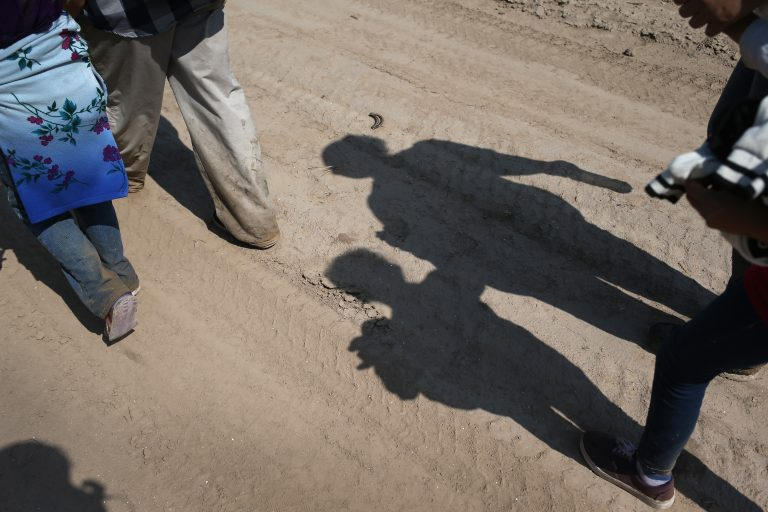 Central American immigrant families walk after crossing from Mexico into the United States to seek asylum in Texas. (John Moore/Getty Images)