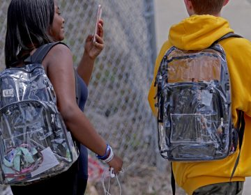Students wear clear backpacks outside Marjory Stoneman Douglas High School in Parkland, Fla., on Monday. The bags are one of a number of security measures the school district has enacted as a result of the Feb. 14 shooting at the school that killed 17. (Sun Sentinel/TNS via Getty Images)