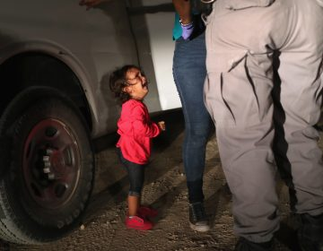 A 2-year-old Honduran girl cries as her mother, who seeks asylum, is detained at the Southern border near McAllen, Texas, in June. (John Moore/Getty Images)