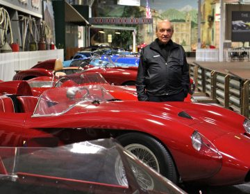Dr. Fred Simeone stands amid his collection at the Simeone Foundation Automotive Museum, which traces the history of auto racing and emphasizes the value of competition as a spur to progress.