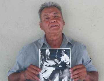 Juan Romero, 67, at his home in Modesto, Calif., holds a photo of himself and Sen. Robert F. Kennedy, taken by The Los Angeles Times' Boris Yaro on June 5, 1968. (Jud Esty-Kendall/StoryCorps)