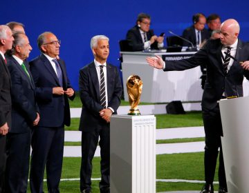 FIFA President Gianni Infantino, right, welcomes representatives of the united bid -- from the U.S., Canada, and Mexico -- as soccer's governing body selects its host for the 2026 FIFA World Cup during the 68th FIFA Congress in Moscow, Russia.