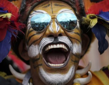 Colombian soccer fan Jose Florentino poses for photos ahead of the 2018 soccer World Cup at a square downtown Moscow, Russia, Wednesday, June 13, 2018. (AP Photo/Felipe Dana)