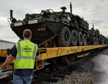 Stryker vehicles are loaded on rail cars at Naval Support Activity, Mechanicsburg to be transported to the National Training Center on June 20, 2018. (Rachel McDevitt/WITF)