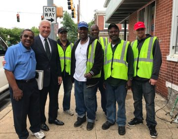 Wilmington Mayor Mike Purzycki stands with Apostle John T. Graham of Temple United Church and neighborhood residents employed to clean city streets and neighborhoods in West Center City. (City of Wilmington)