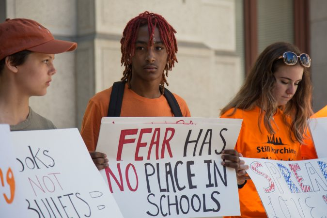 Khalil Lewis-Ra, 14, (center) helped organize the
