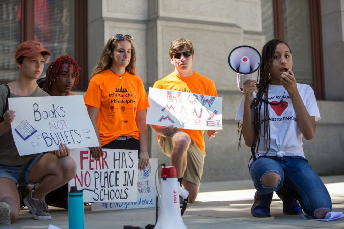 Simone Akridge, 15, takes a knee as she gives a powerful speech about how gun violence has affected her family and how necessary gun reform and voting is. Around 70 supporters gathered together for a march from the Philadelphia Art Museum to Independence Mall 105 days after the