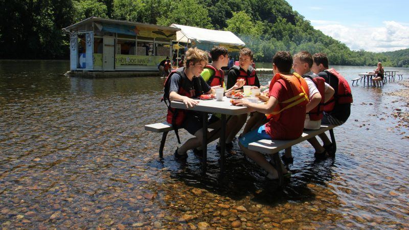 Located in a remote spot on the Delaware River tubing route, the Famous River Hot Dog Man is the only game in town for tubers, whose lazy journeys can last four to six hours. (Emma Lee/WHYY)