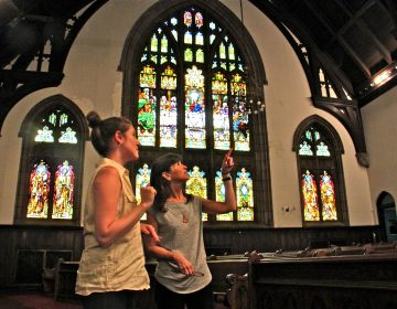 Heidi Segall Levi of Community Design Collaborative (right) and Rachel Hildebrandt of Partners for Sacred Places talk about potential uses for the main sanctuary in Wharton-Wesley United Methodist Church.