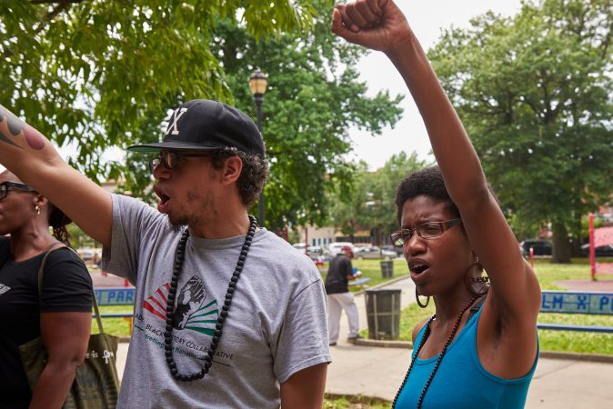 Ismael Jiminez, 36, stands next to his wife, Ashley Jiminez, 32 at the Solidarity for Antwon Rose Rally in Philadelphia on July 1, 2018. Together they chant,