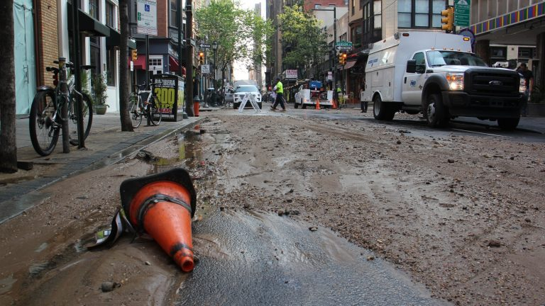 Silt and debris fill Center City streets around the site of a massive water main break. (Emma Lee/WHYY)