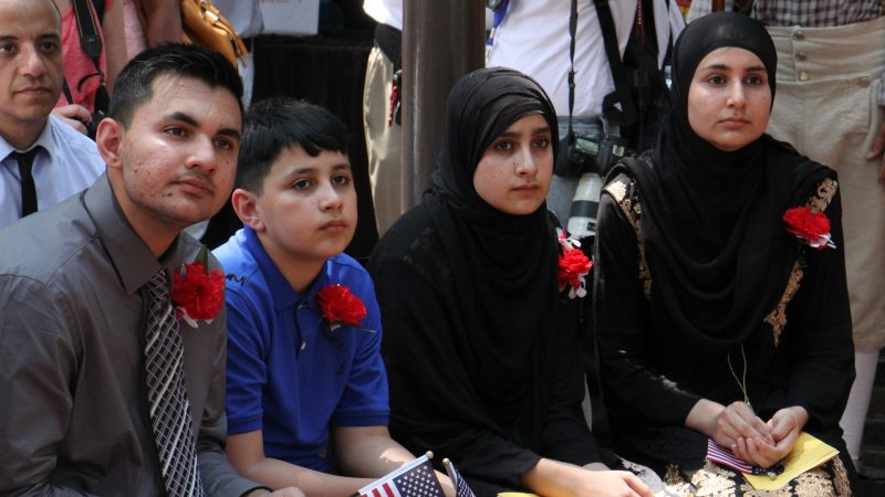Four members of the Ali family from Pakistan, (from left) Asad, 14, Abid, 10, Gulalai, 11, and Gulghotai, 12, became  U.S. citizens at a Fourth of July naturalization ceremony at the Betsy Ross house. (Emma Lee/WHYY)