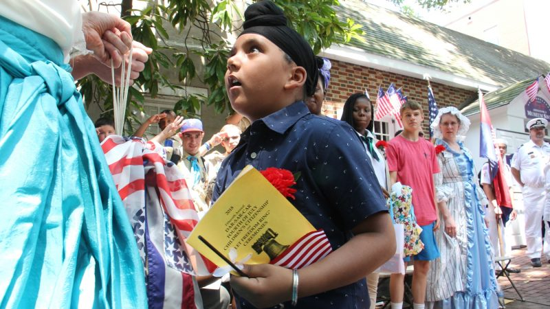 Gurvansh Singh, 7, rings a bell as part of the July 4