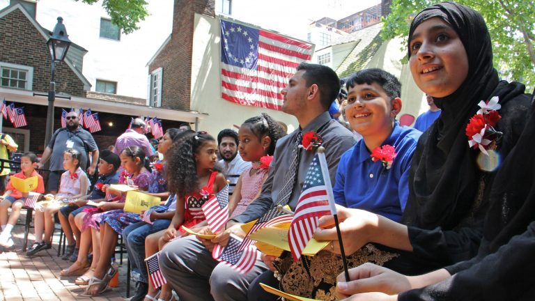 Thirteen children from seven nations took the Oath of Allegience to become U.S. citizens during a naturalization ceremony at the Betsy Ross House in Philadelphia on July 4, 2018. (Emma Lee/WHYY)