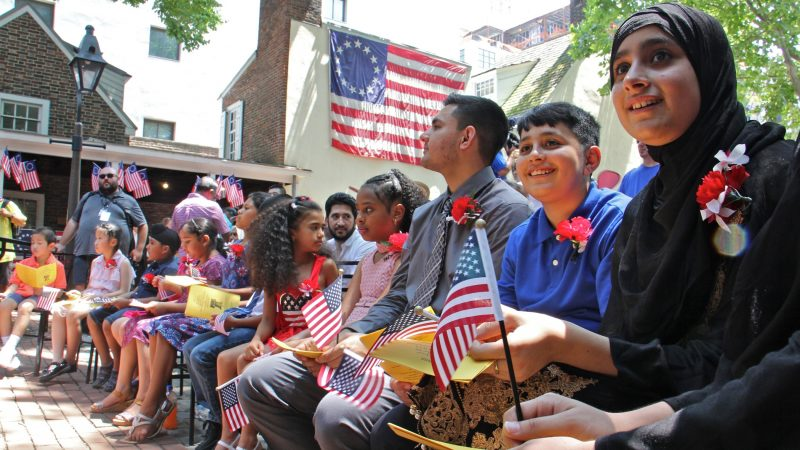 Thirteen children from seven nations took the Oath of Allegience to become U.S. citizens during a naturalization ceremony at the Betsy Ross House in Philadelphia. (Emma Lee/WHYY)