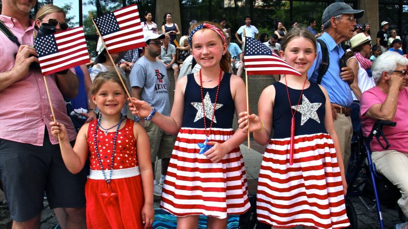 The Sweeney sisters (from left), Meika, 5, Maddison, 10, and Morgan, 7, traveled from Seattle to celebrate Independence Day in Philadelphia. (Emma Lee/WHYY)