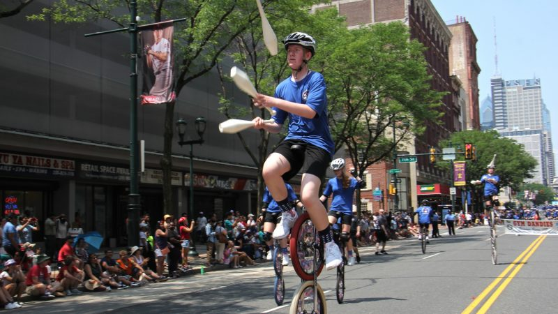 The Gym Dandies, trick cyclists from Scarborough Schools, Maine, perform during the Philadelphia Independence Day parade. (Emma Lee/WHYY)