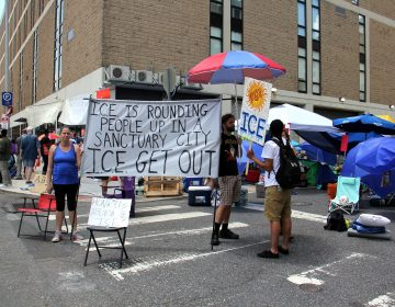 Protesters camped outside Immigration and Customs Enforcement (ICE) offices at 8th and Cherry streets are demanding that Mayor Jim Kenney end the city's data sharing contract with ICE.