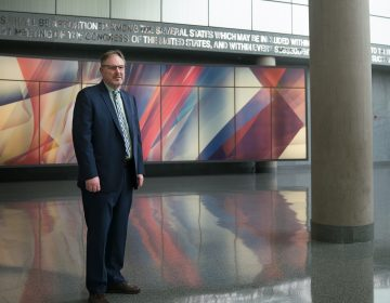 Acting U.S. Census Bureau Director Ron Jarmin stands in the lobby of the agency's headquarters in Suitland, Md. The bureau isfacing six lawsuits from more than two dozen states and cities, plus other groups, that want a new question about U.S. citizenship removedfrom the 2020 censu