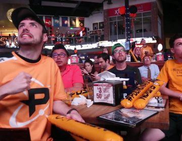 Fans of the professional video gaming team, the Philadelphia Fusion, gather at Xfinity Live to watch the first round in the Overwatch League playoffs. (Emily Cohen/WHYY)