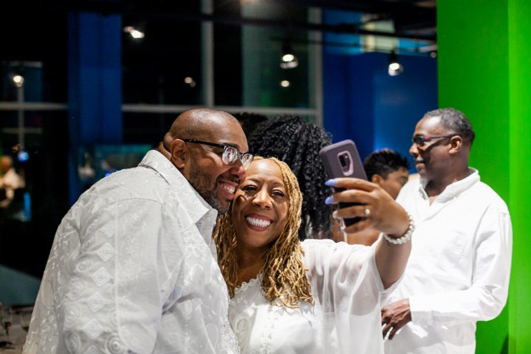 Big Scott, organizer of the All White Affair at Adventure Aquarium in Camden, NJ is pictured with WBAS Radio personality Patty Jackson. (Brad Larrison for WHYY)