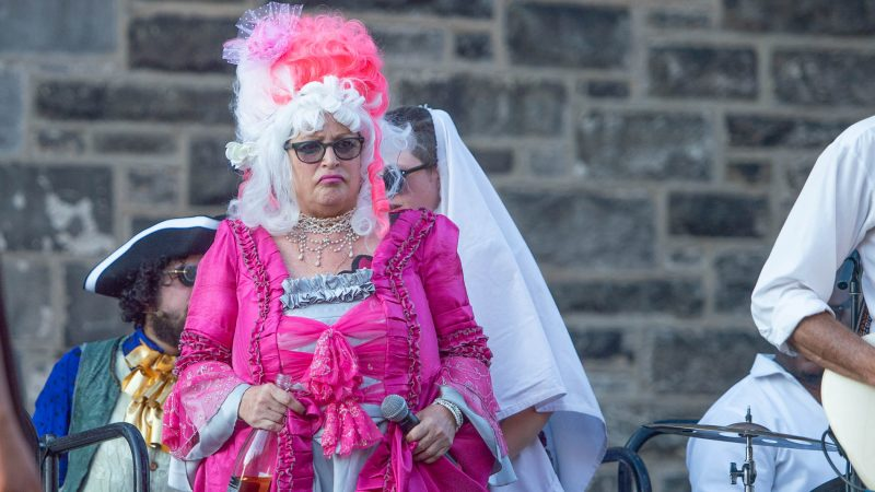 Marie Antoinette, portrayed by Terry McNally, is escorted from the tower to confront Edith Piaf, portrayed by John Jarboe. (Jonathan Wilson for WHYY)